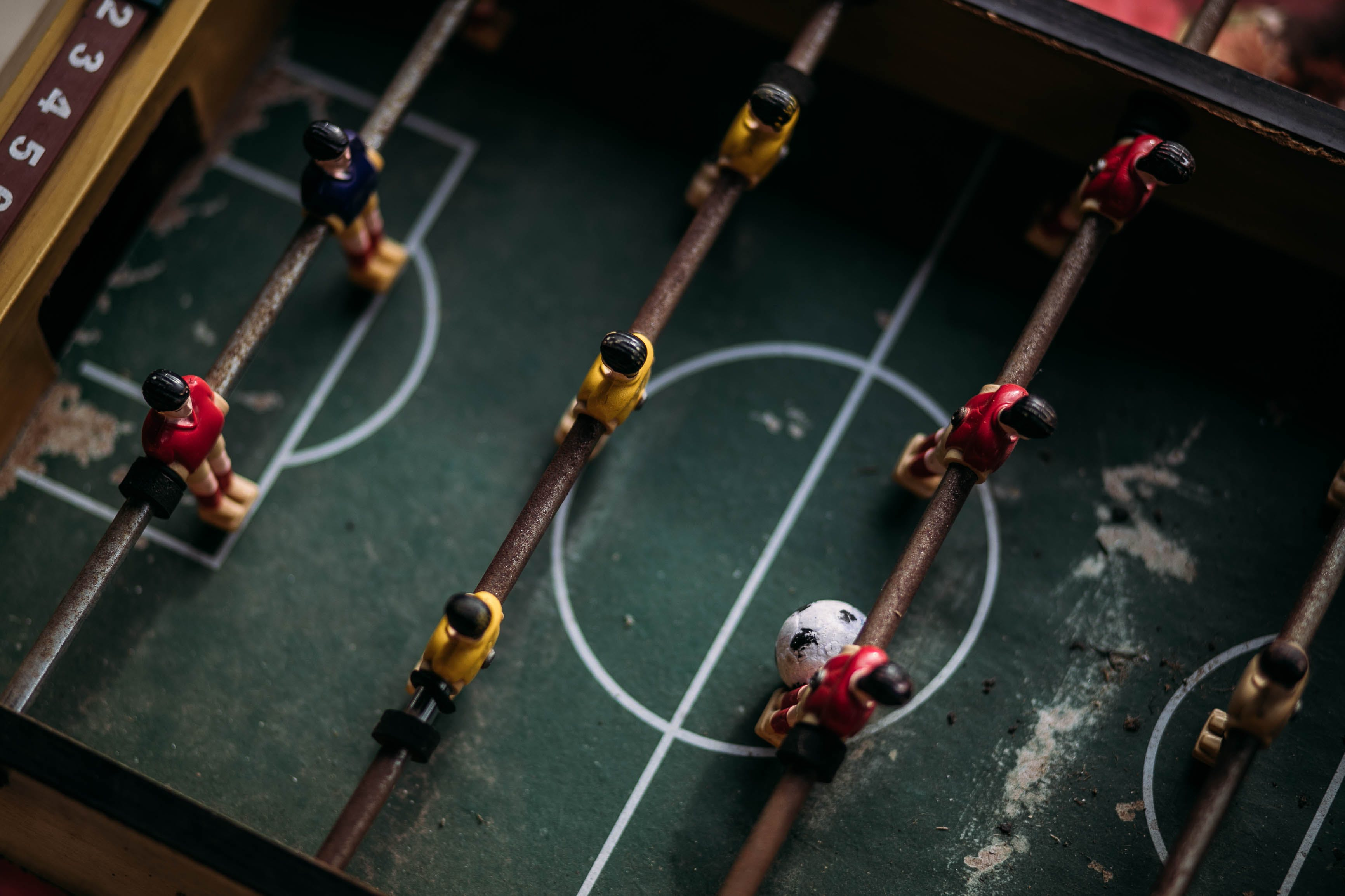 Close-up and Top Photography of Football Table
