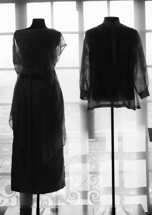 Dress and Shirt on Display Beside Window