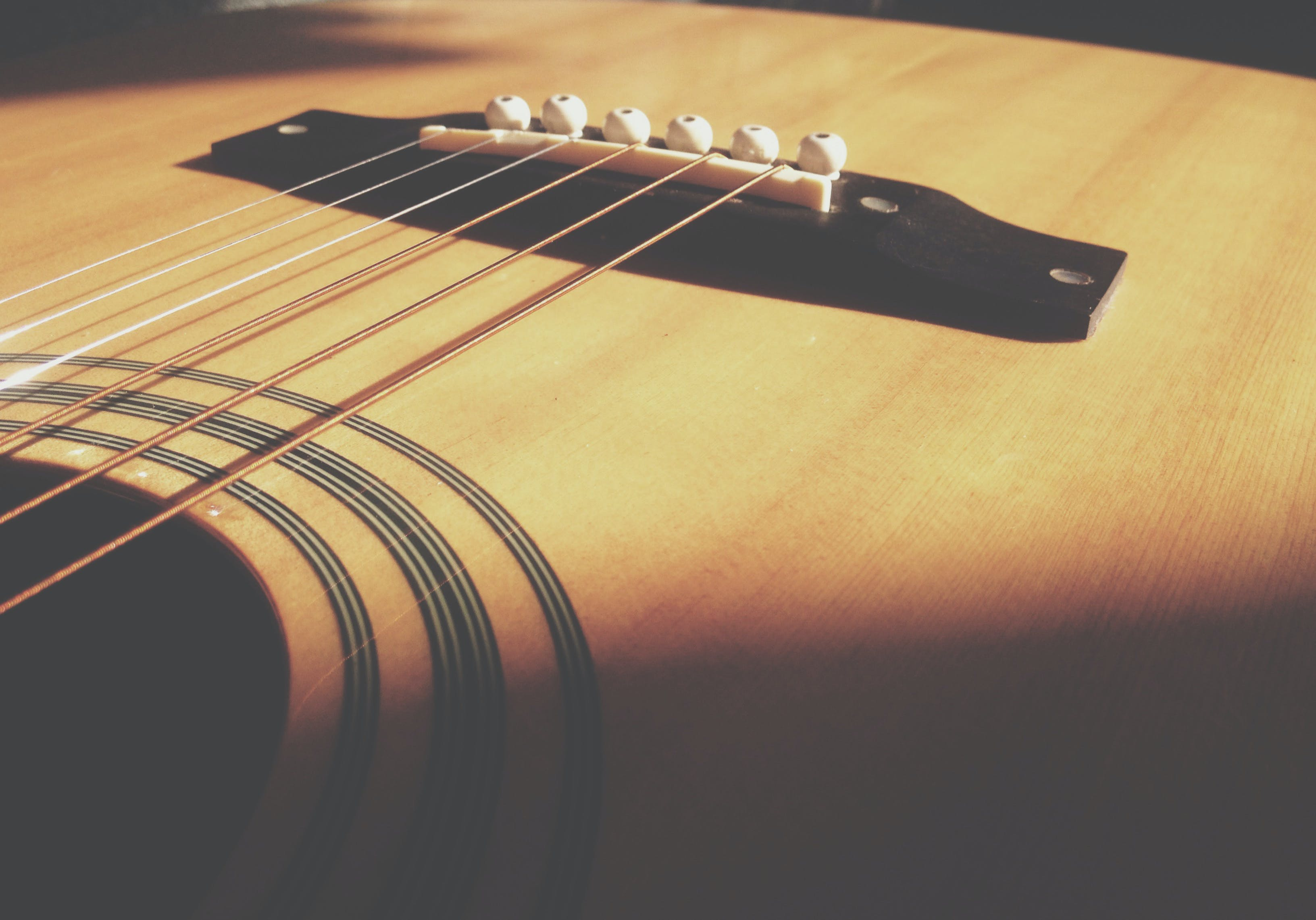 Closeup Photo of Acoustic Guitar Body and String