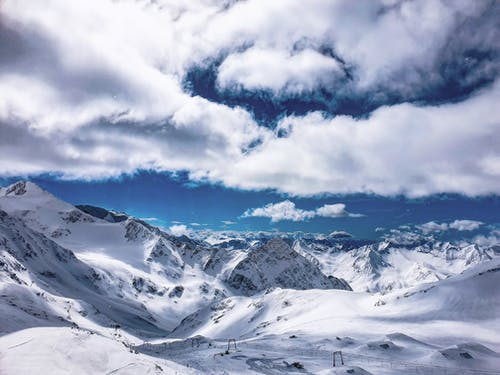 White Clouds Hovering Above Snow Mountain Slope Resort