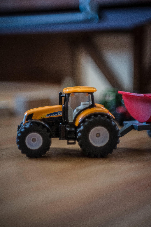 Orange and Black Front Loader Plastic Toy