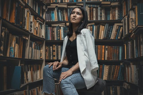 Woman Sitting on Library