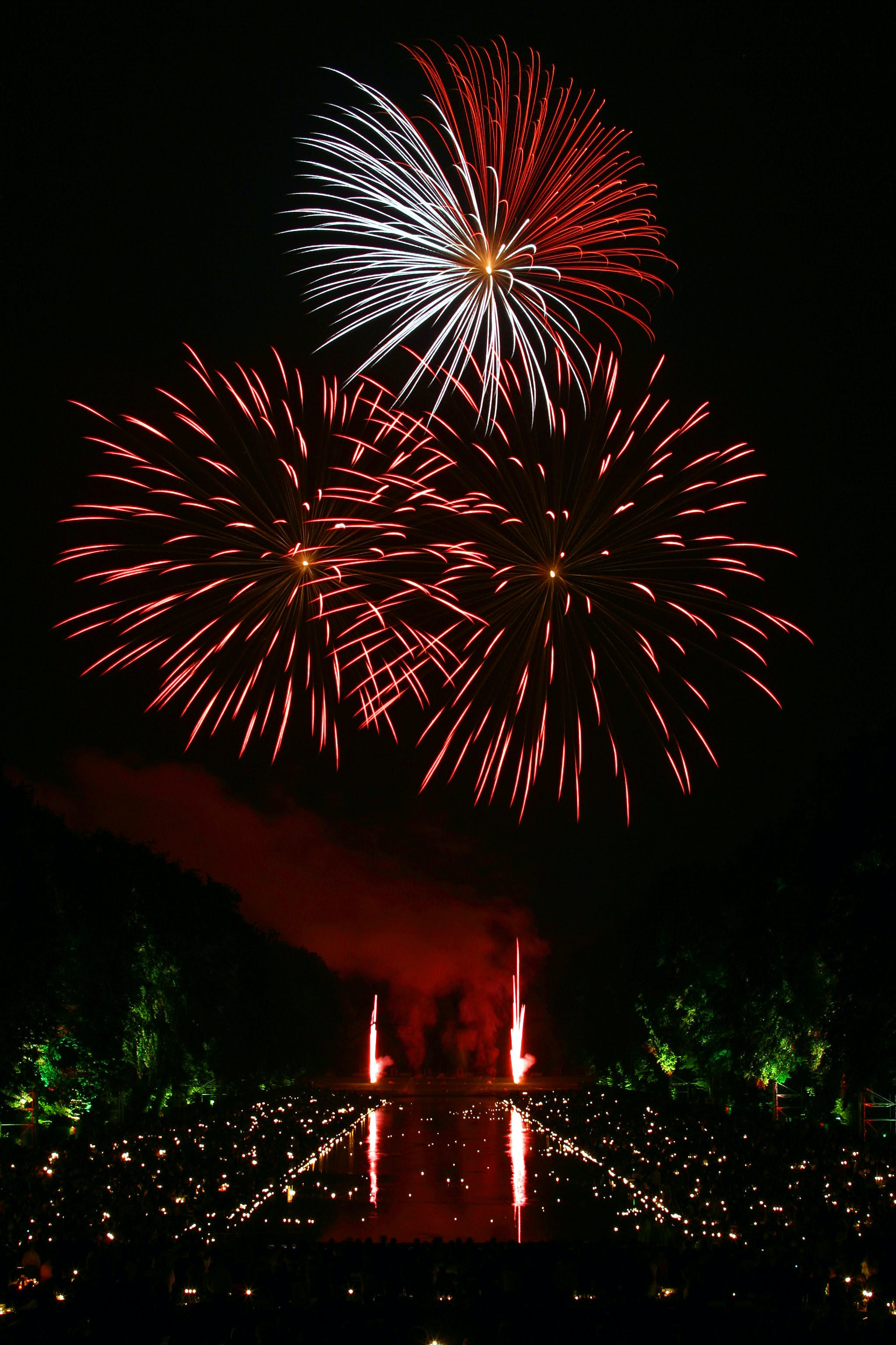 Red and White Fireworks Scattered during Nighttime