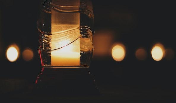 Pillar Candle Inside Glass Bottle