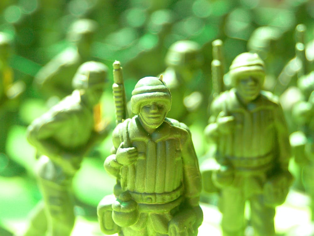 Green Army Toys Selective-focus Photography