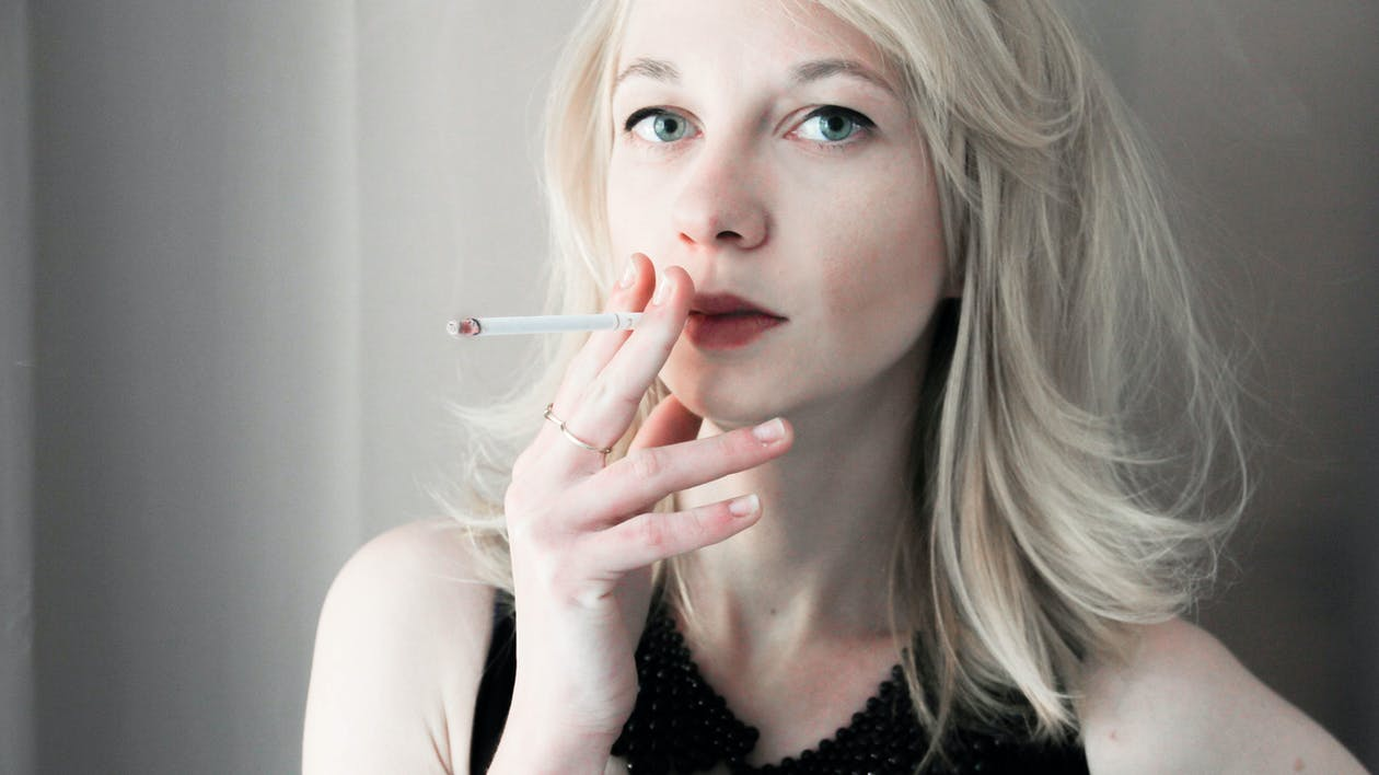 Woman Holding Cigarette Stick