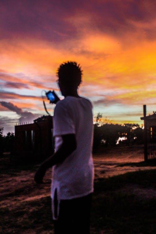 Free stock photo of light signal, orange skies, sunset beach