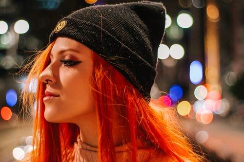 Close-Up Photo of Woman Wearing Black Bonnet
