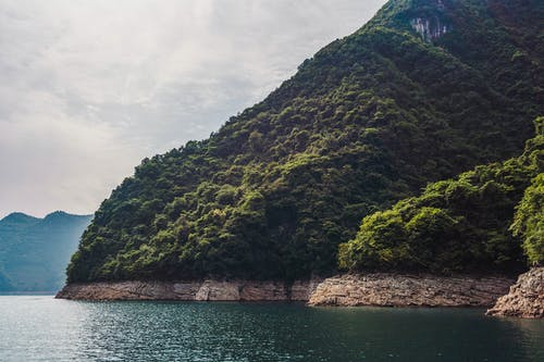 Landscape Photo of Mountain Near Body of Water