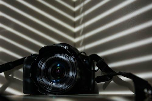 Free stock photo of asymmetry, camera, camera lens, camera strap