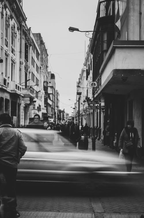 Monochrome Photo of People Walking on Street