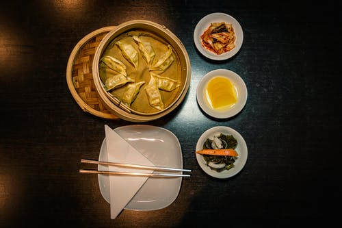 Chopsticks on Plate Near Foods on Plates