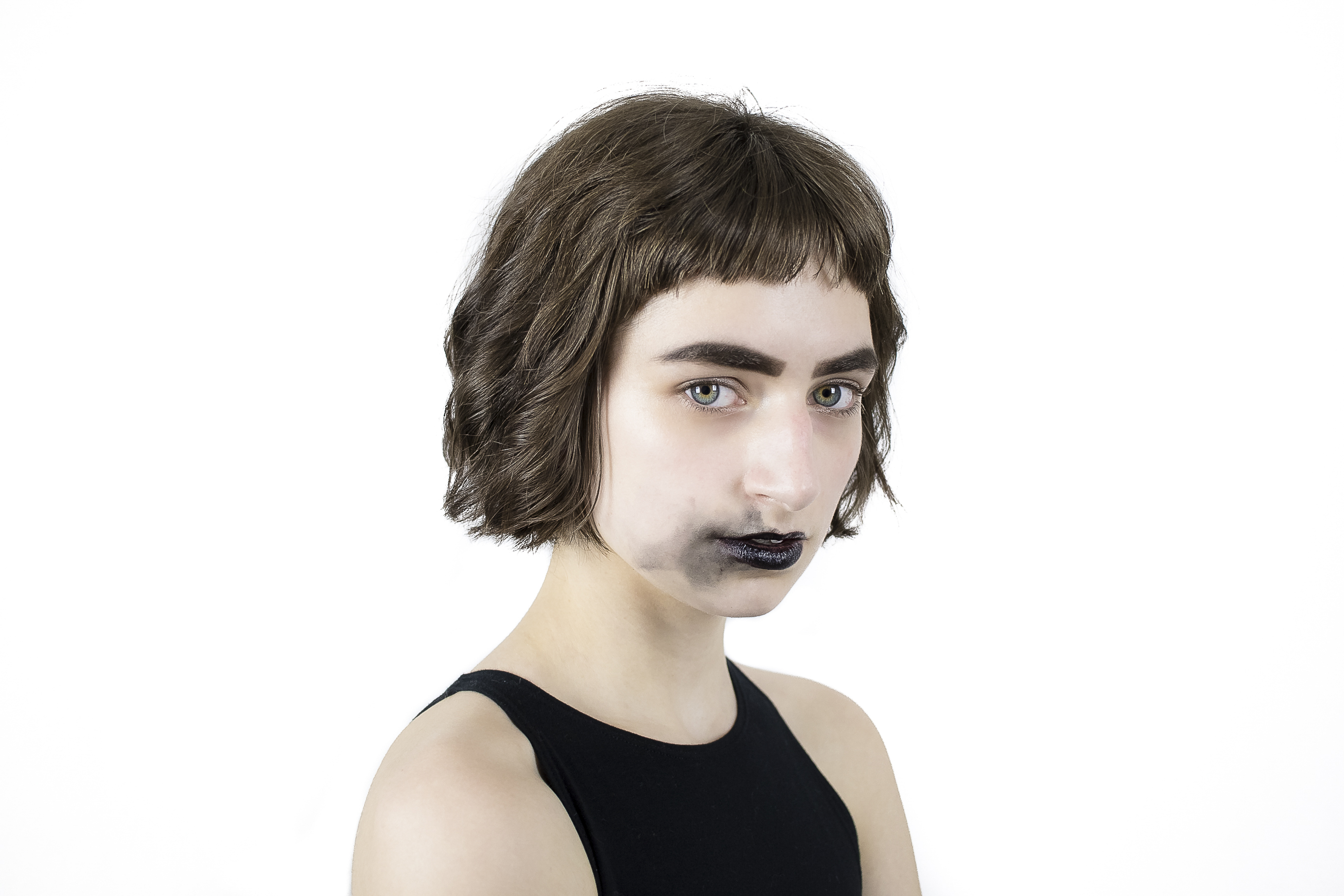 Portrait Photo of Woman in Black Sleeveless Top With Smudged Black Lipstick