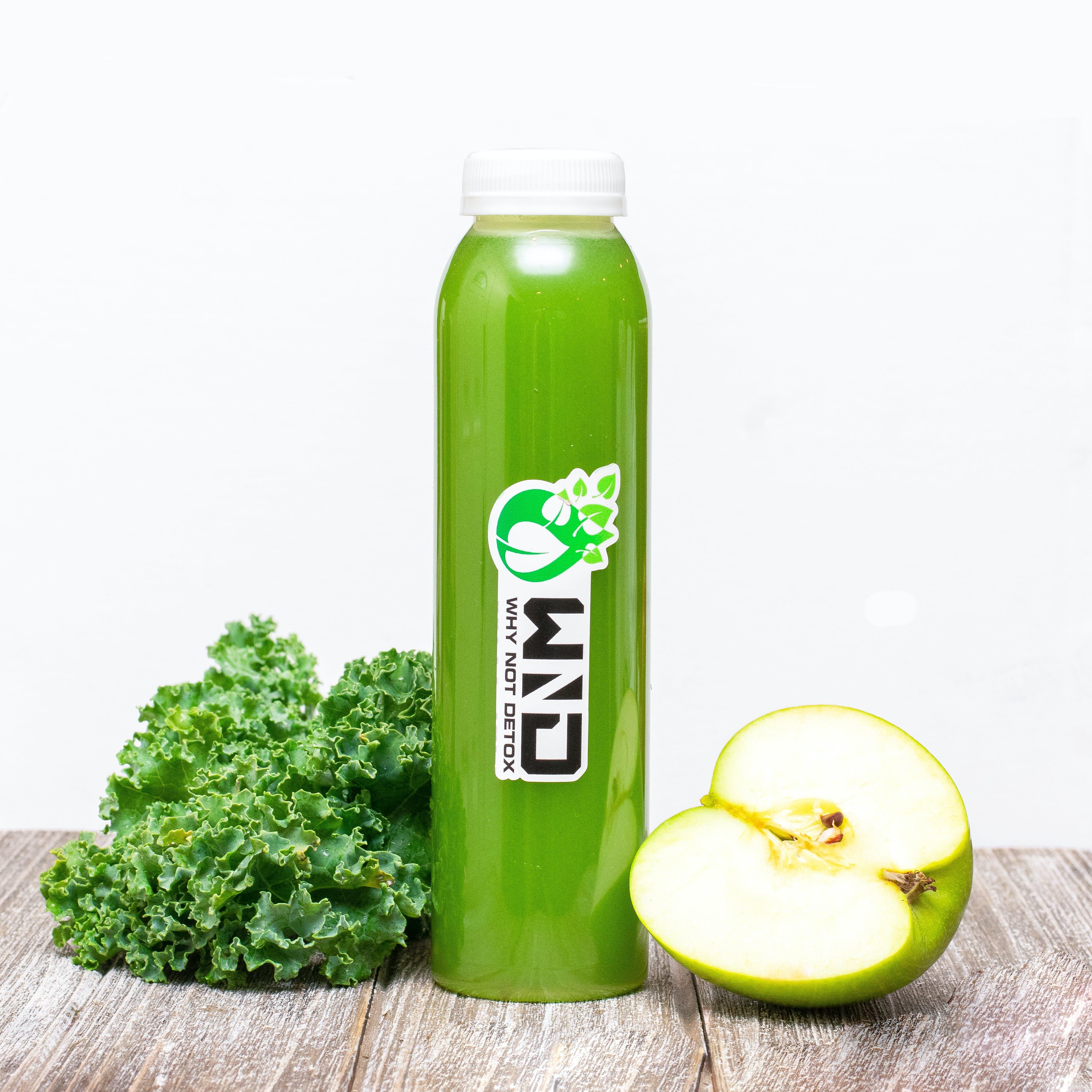 Green Plastic Bottle Beside Green Apple