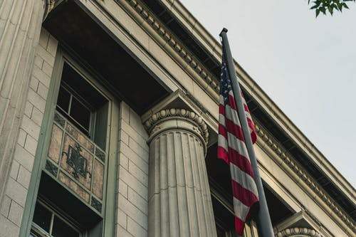 Free stock photo of American flag, building, courthouse, flag