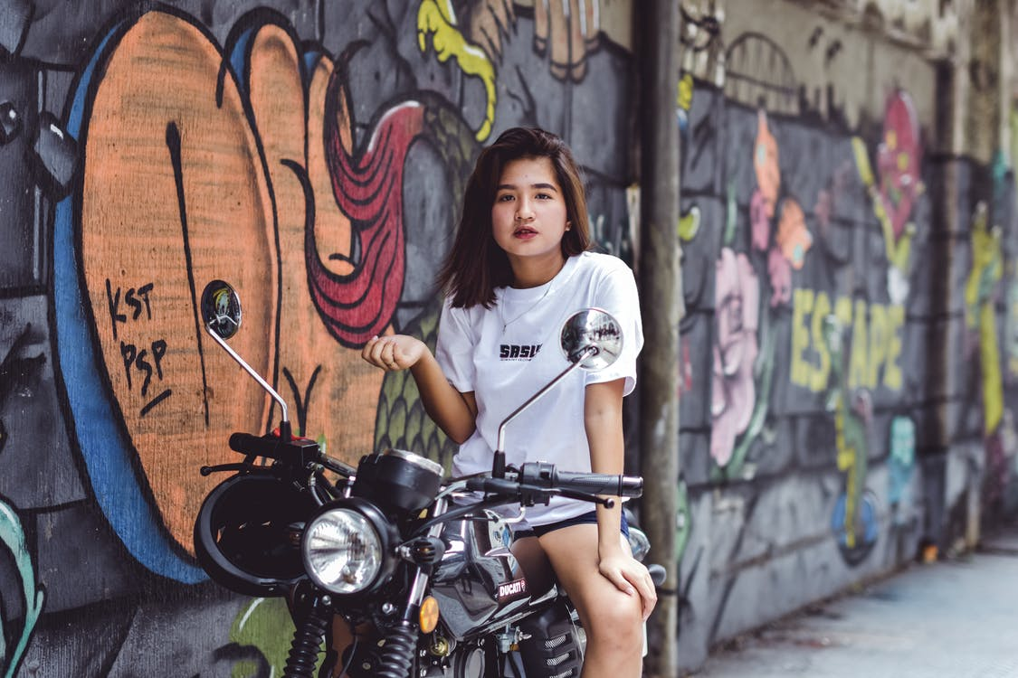 Photo of Woman Sitting on Motorcycle