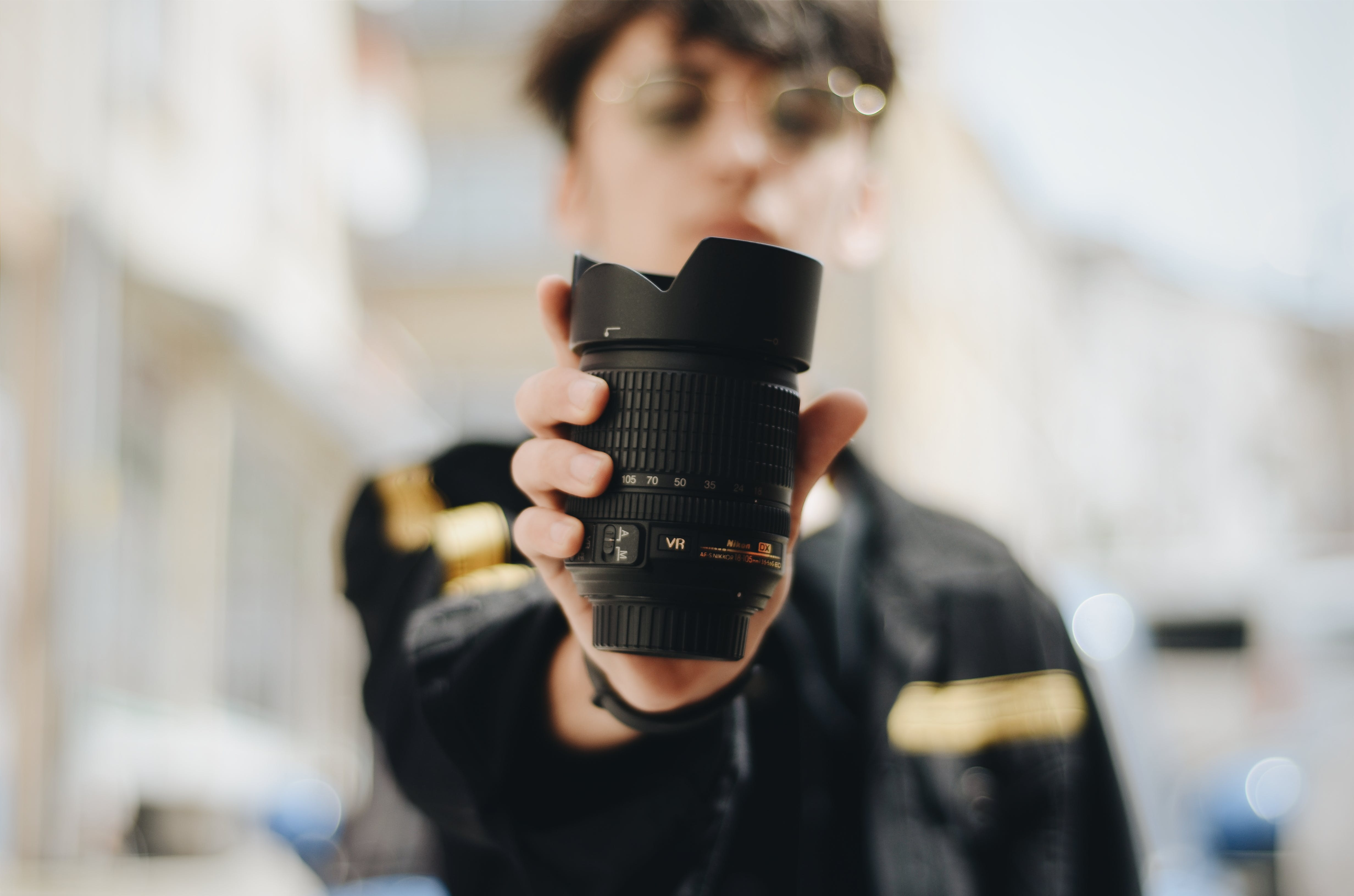 Person Holding Zoom Lens