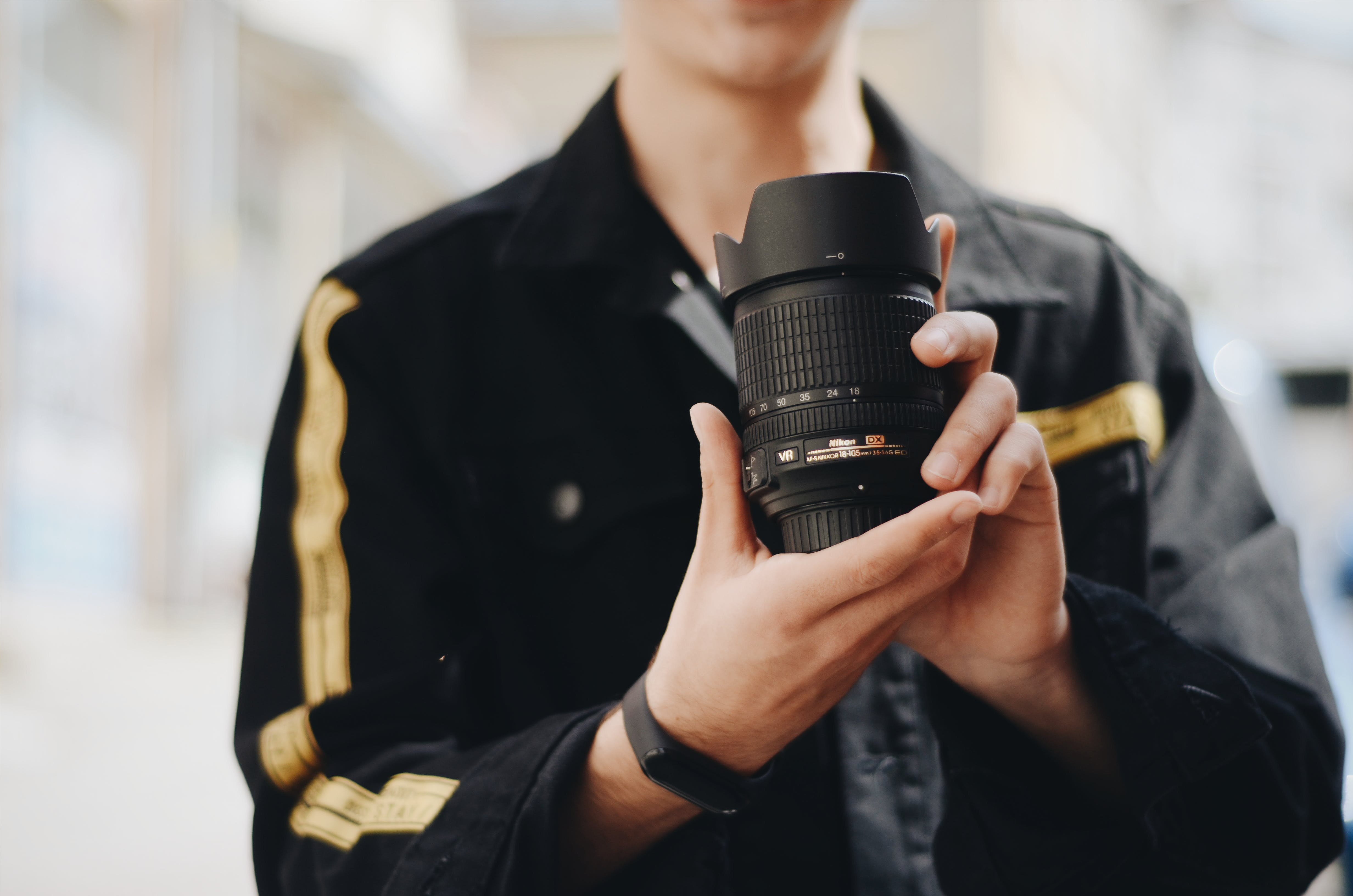 Person Holding Black Dslr Camera Lens