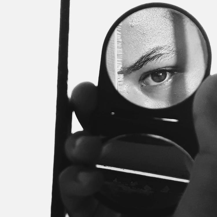 Photo Of Person Holding Mirror