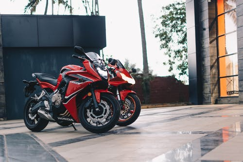 Photo of Parked Red and Black Sport Bikes