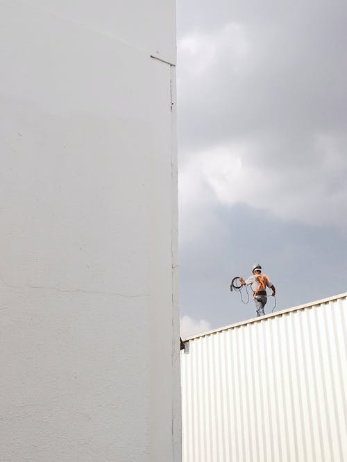 Man Walking on Roof Top