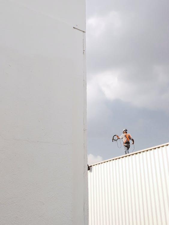 Man Walking on Roof Top