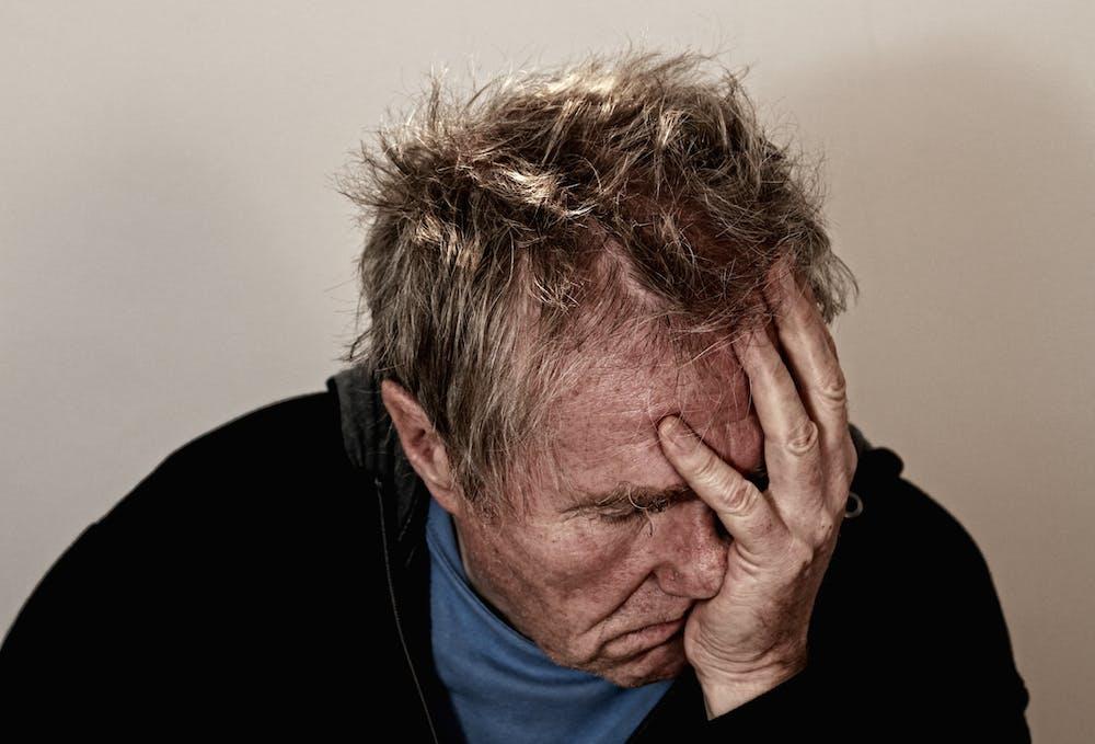 Sick man holding his face.   Photo: Pexels