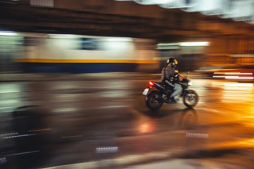 Time Lapse Photo of Person Riding Motorcycle during Nighttime