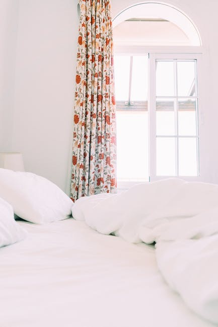 White room with floral curtain