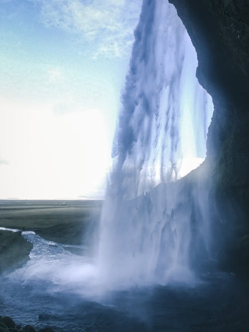 Raging Waterfalls Under White Clouds