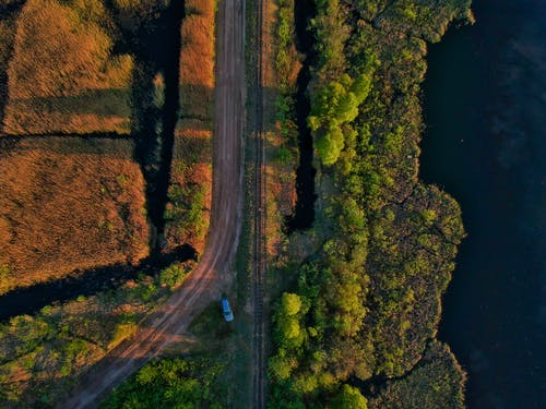 Aerial Photo of Blue Car Parked on Side of Road