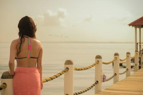 Free stock photo of beach, dock, girl, sea