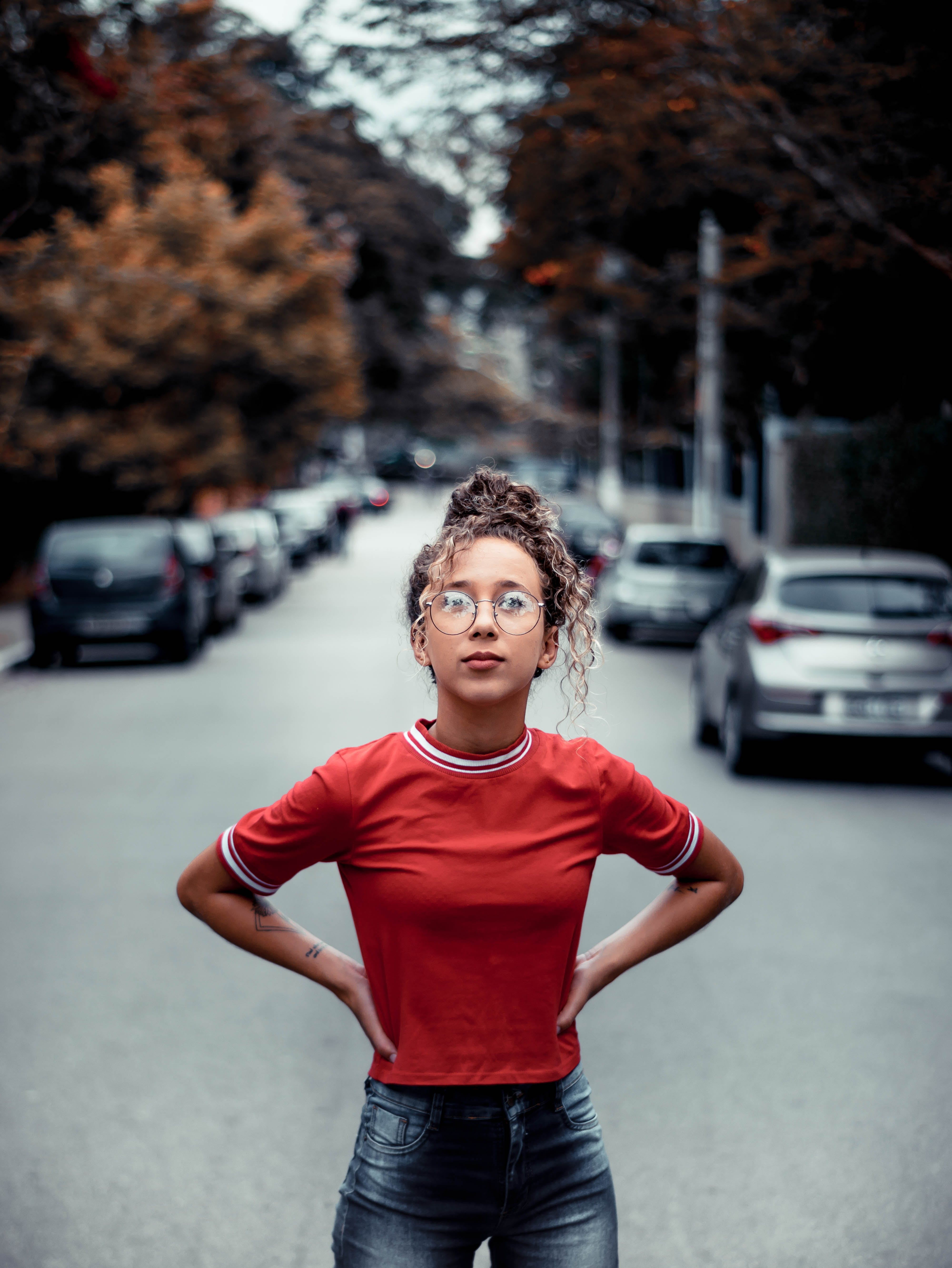 Shallow Focus Photo Of Woman In Red Crew Neck T-shirt