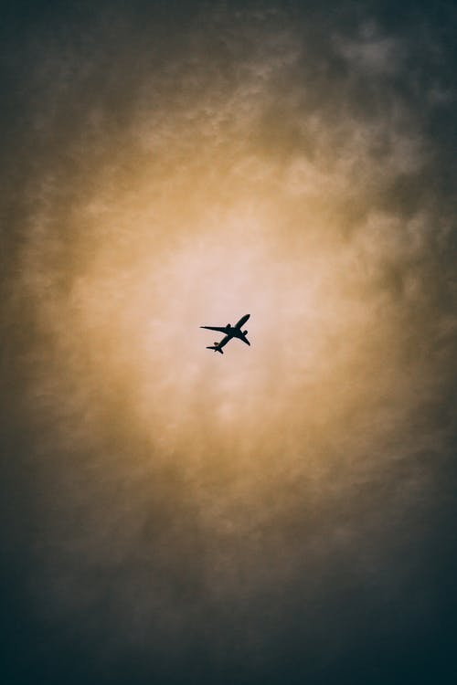Silhouette Photography of an Airplane Flying
