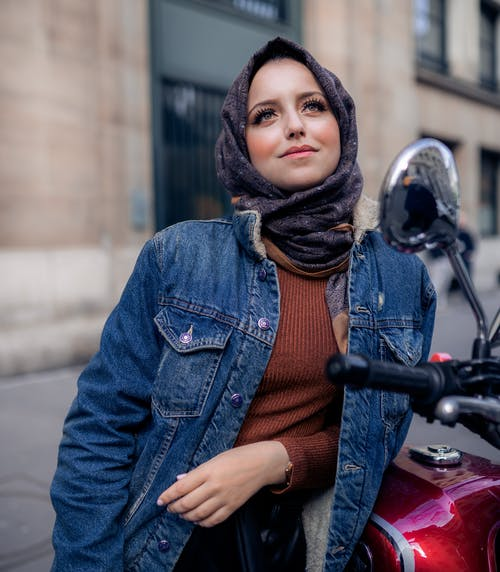 Woman In Blue Denim Jacket