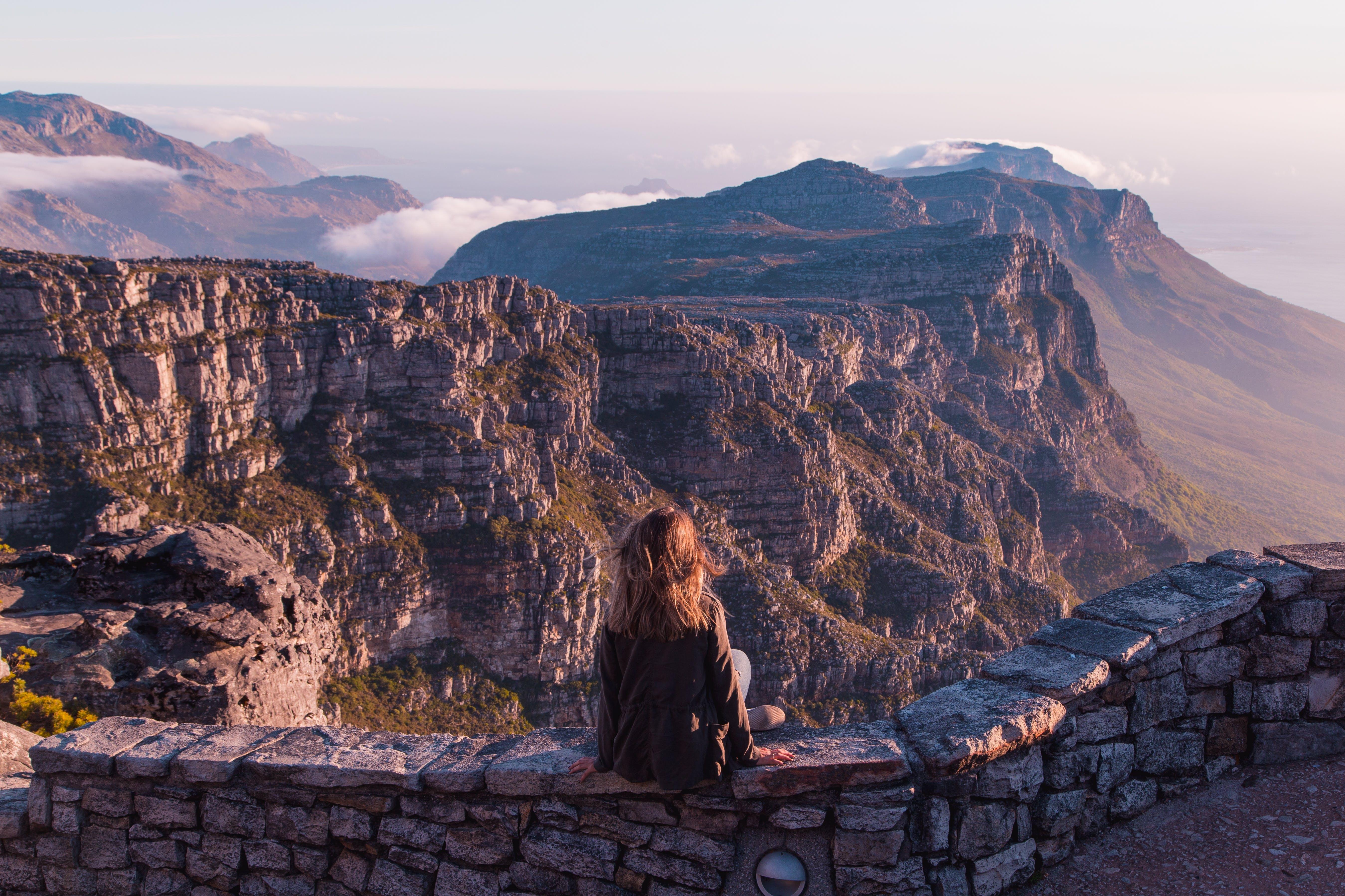 woman sitting on stonewall