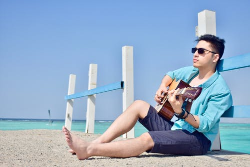 Free stock photo of 20-25 years old man, acoustic guitar, background, barefoot