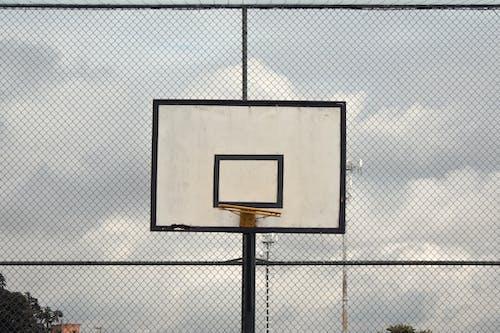 Photo of Basketball Hoop Near Cyclone Fence