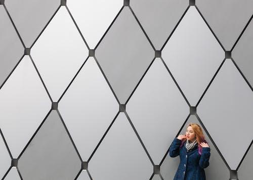 Woman Near Grey Wall