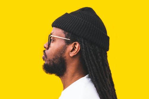 Foto d'estoc gratuïta de africà, afroamericà, de perfil, gorra de punt