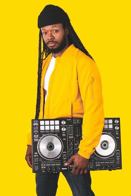 Man carrying dj mixing console