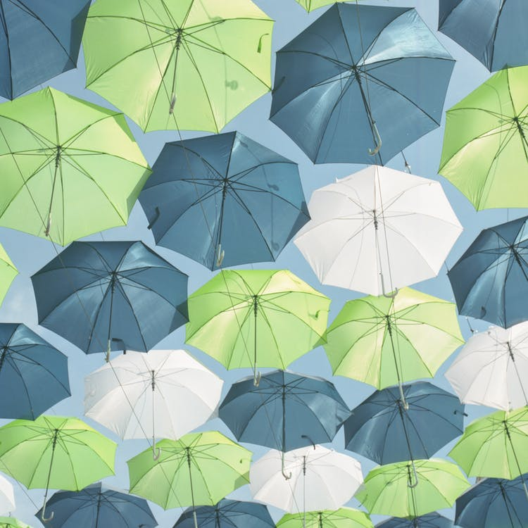 Hanged Green, White, and Gray Umbrellas