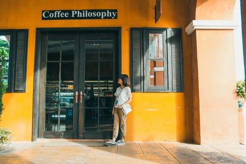 Girl Standing Outside Coffee Philosophy Room