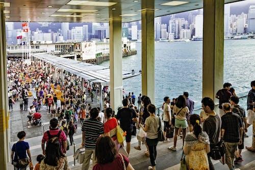 People Walking Near Body of Water