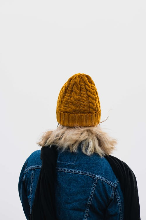 Back View Photo of Woman in Blue Denim Jacket and Mustard Beanie