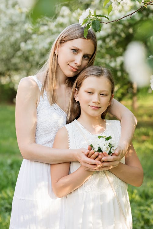 Woman and Girl Holding Bouquet