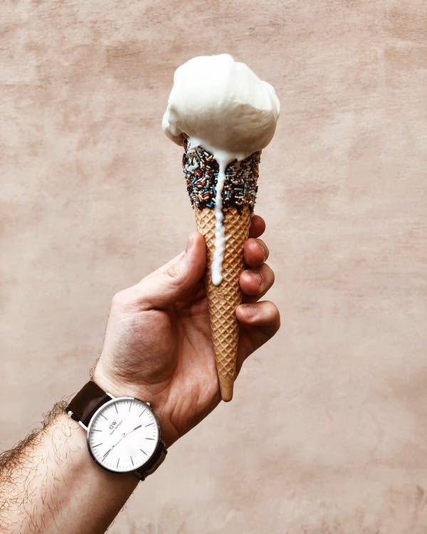 Close-up Photo of Man Holding Melting Ice Cream Cone