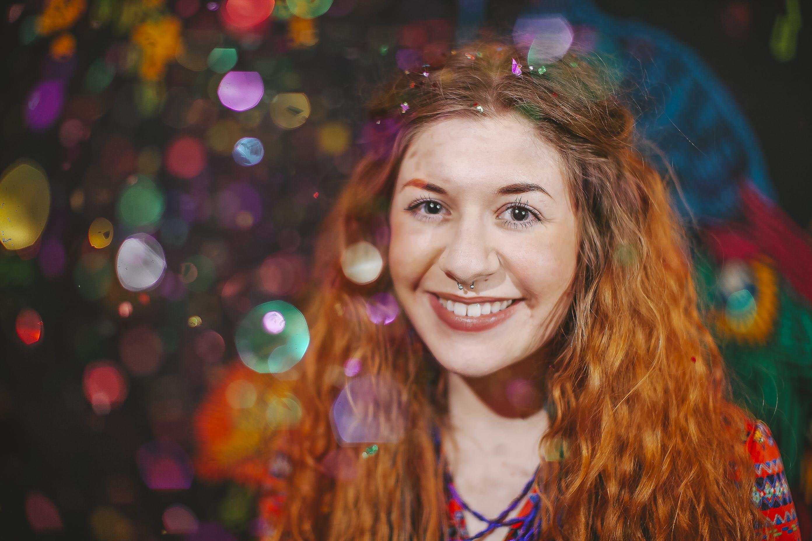 Woman With Orange Hair Smiling