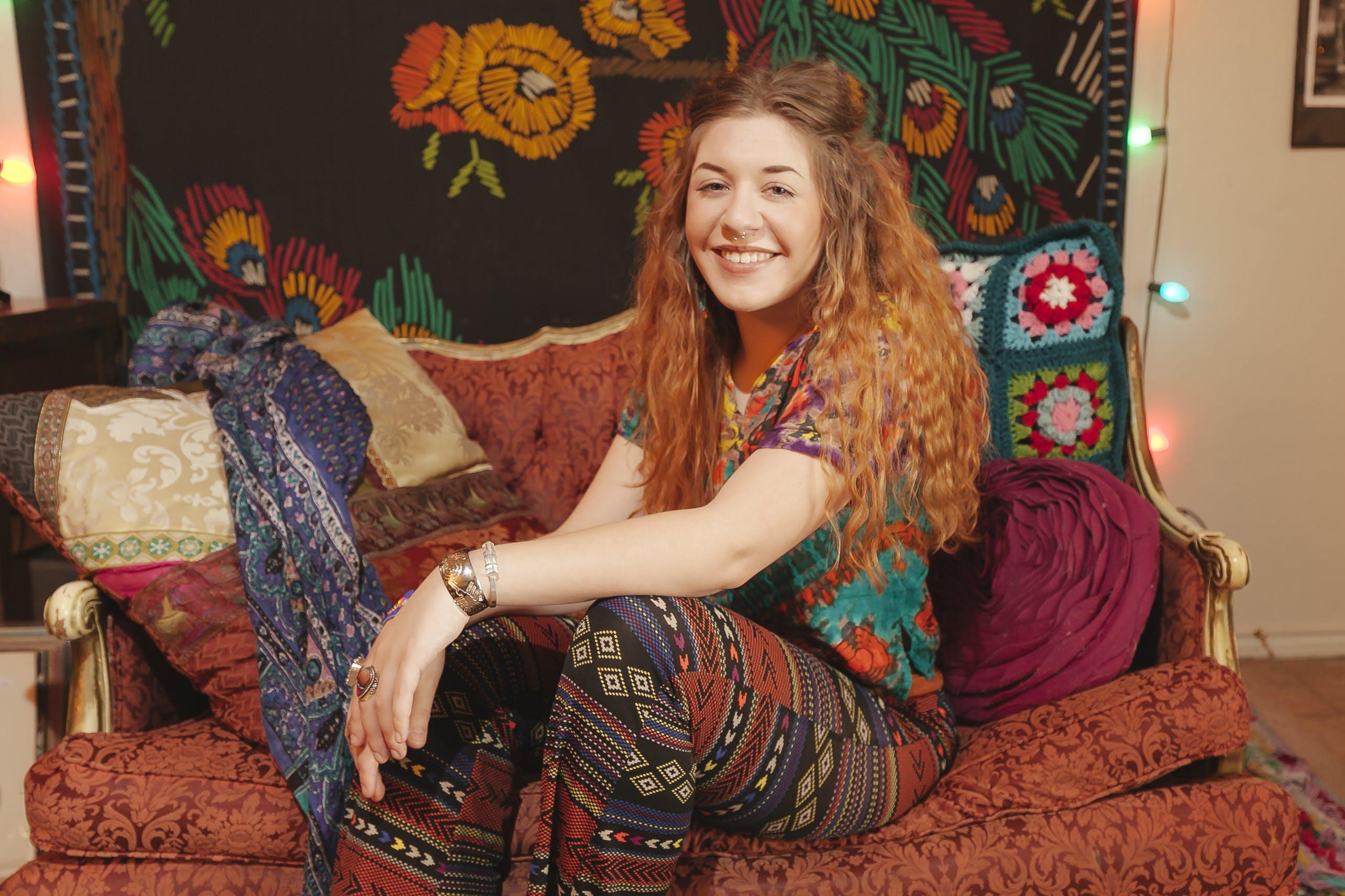 Woman Sitting On Sofa Smiling