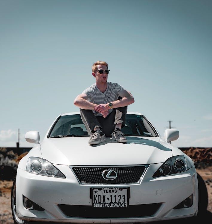 Man Sitting on Lexus Vehicle